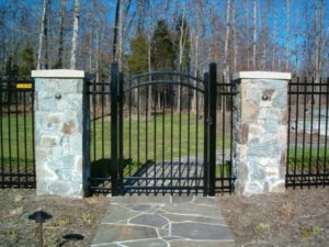 Steel Fence with an Arched Gate Driveway Hercules Fence Newport News